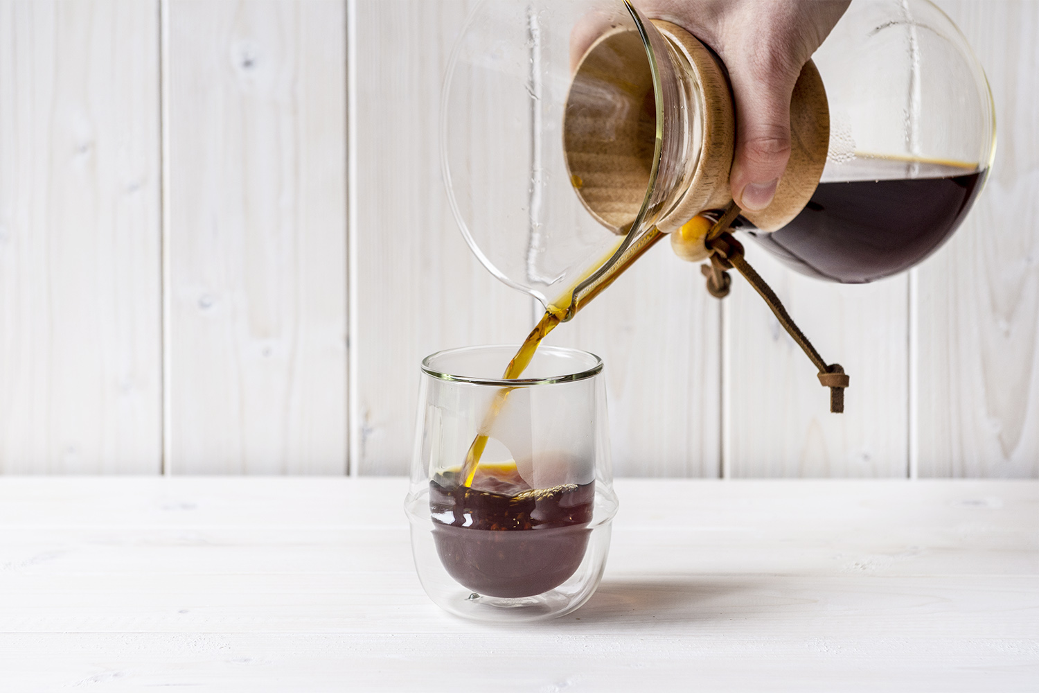 Coffee pouring into double walled cup